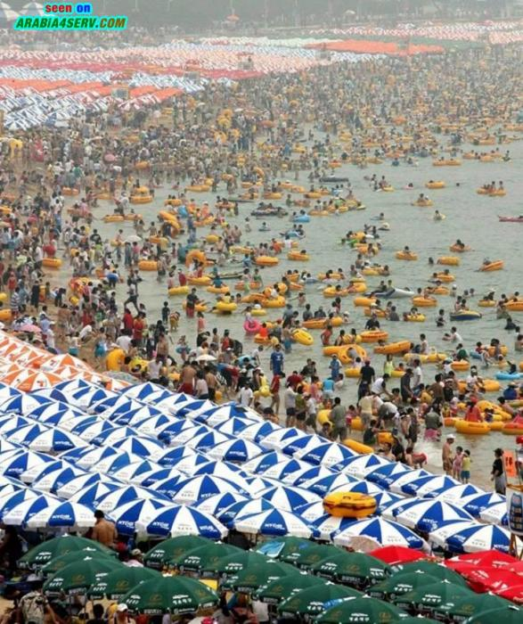 صور شاطئ بحر صينى - زحام الشواطئ في الصين