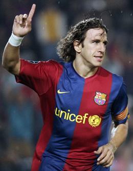 صور لاعب برشلونة والكابتن puyol